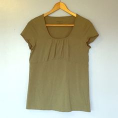 Geoffrey Beene Sage Green Top Super cute and comfortable sage green short sleeve t-shirt with some stretch for comfort! Gently used with no stains or tears. Lots of wear left! Geoffrey Beene Tops Tees - Short Sleeve