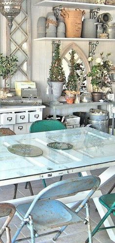 This repursed door turned dining table is the perfect compliment to this beachy greenhouse. Refurbished doors. Vintage doors. Door table. Interior design. Greenhouse style.