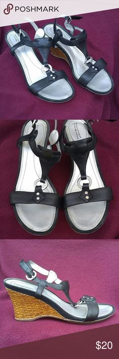 Rockport black wedge sandals Gently worn black wedge sandals. Wedge is Carmel brown color.  Wedge heel is 3 inches high. Comes from a smoke free home.   Box is included if desired. Rockport Shoes