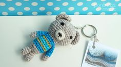 Handmade crocheted bear.    Colors: gray, blue, dark yelloy and lemmon yellow