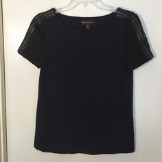 Blue and black business/fun top Cute top with some good structure to it. Can wear it with some skinny black jeans/leggings and stilettos. Worn twice. Has pleather lines along the zippers on the shoulders. Good condition. Dana Buchman Tops Blouses