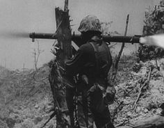 A 1st Marine Division bazooka man fires his M1A1 rocket launcher during the campaign for Peleliu. The bazooka was an effective weapon for destroying Japanese armor and defensive complexes. Still image from USMC motion picture film