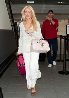 Gretchen Rossi Photo - Gretchen Rossi and Slade Smiley at the Airport