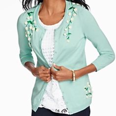 """New - Talbot pom pom cardigan This charming cardigan has all the Pretty poms that adds fun & garden fresh buds.  Feminine and easy-to-wear in soft, spring pastels, the streamlined silhouette is clever and curve-enhancing with a subtle, natural stretch. Beautiful buds adorn the waist and shoulders for a fun   Crew neck Grosgrain ribbon-trimmed placket Three-quarter sleeves Button front 24"""" long-at hip length Body: 60% cotton/40% rayon Decoration: 60% cotton/30% nylon/10% merino wool Machine…"""