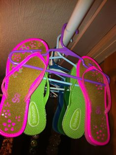 Used childrens hangers to organize flip flops and sandals.