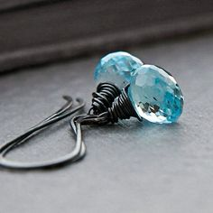 love the wire wrap, but maybe with a green stone instead of blue ~J