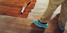 You can clean and refinish a scratched wood floor without having to sand down to bare wood