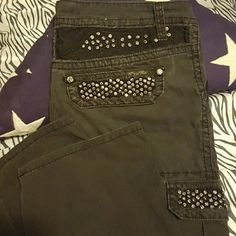 Like NEW!!  Miss Me black cargo pants size 27 Just lowered!! These have only been worn and hand washed ONE time. Miss me black 61251 cargo pants. Size 27 (15 in) low rise. Inseam is 31 1/2 and they are boot cut. 100% soft cotton so they are a light fabric not denim. Bought at Buckle and in PERFECT condition! At the top & on the pocket flaps there is lace insets as well under the rhinstones.  Lots of bling!!  These pictures just do not do these pants justice!! They are so cute on!!!  Love…