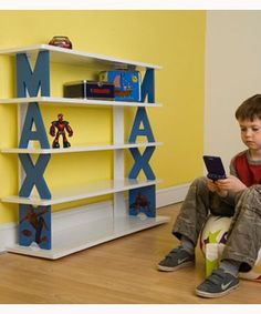 Childrens Bookshelves with Personalised Letters - super cute!  Love this, would have to do with 2 letter combos since most of our books are so big! Definately want to do this.