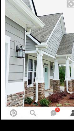 Siding, shakes, stone, fun door color... love this look!