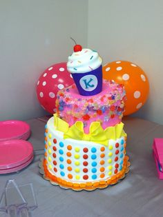 love the simplicity and look of candy dots on white. not rest of the cake, tho adorable for candyland cake  Candy land themed baby shower cake