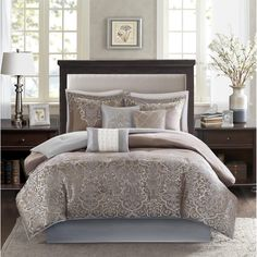 Create an opulent look in your master bedroom with the Madison Park Camille Comforter Set. The woven jacquard design provides texture in the solid brown portion while a the decorative motif comes up from the bottom of the bed to the center.