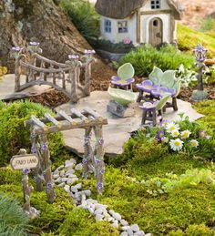 Miniature Fairy Garden Fairy Lane Set is a delightful addition to your miniature or fairy garden. Set includes Fairy Lane sign, arbor, foot bridge, seating set and lamppost, all beautifully accented with pretty purple flowers. It looks like the fairies themselves crafted each of these beautiful pieces. - DIY Fairy Gardens