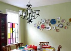 We really love this arrangement of plates — what a lovely, homey way to decorate a kitchen or a dining nook.
