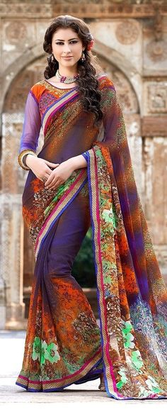 Multi Color Printed Light Border Fancy Party Wear Sarees lace border work multi color printed flower in a whole saree, comes with heavy embroidery work  mix fabric unstitched orange blouse with net blue sleeves.