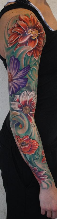Ty McEwen - Flower sleeve tattoo.....in love but with different colors and flowers add some stuff