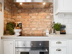 small kitchen, brick wall