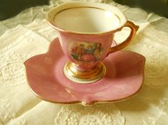 Pink Bone China Tea Cup with Victorian Couple, trimmed in gold. Saucer is leaf shaped and cup has gold pedestal foot. Pink background with circles of polka dots. So pretty! Tea Pitcher, Vintage Gifts, Vintage Tea, Vintage Style, Bone China Tea Cups, My Cup Of Tea, Tea Service, Chocolate Pots, Vintage Dishes
