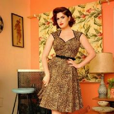 "Pinup Couture Heidi Dress in Leopard Print Size Medium , Never worn Modern pinup dress with a swing skirt  Sateen trim along the neckline and sleeves 1"" grommeted belt 23"" Zipper up the back  Made from high quality stretch sateen ment to hug curves Dresses Midi"