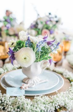 purple and green centerpiece, photo by Becky Williamson Photography http://ruffledblog.com/nautical-romance-wedding-ideas-in-charleston #vintagewedding #weddingideas