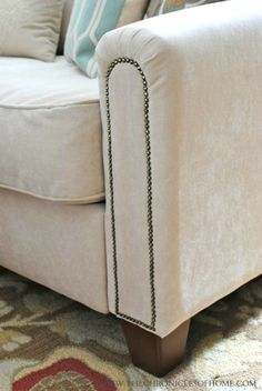 Great reupholstery tips....including adding nail head trim!