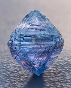 Beautiful raw blue diamond. Note the other bits of color in it