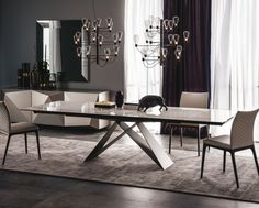 Premier Keramik Is An Extendible Dining Table With Base In Titanium,  Graphite Or Black Embossed Lacquered Steel. Laminam Fokos Ceramic Top And  Extensions In ...