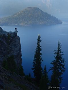 Crater lake is the deepest lake in North America. Wizard Island peacefully hovers in the distance.