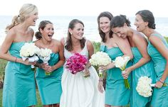 love the bride's bright bouquet -- and the different flowers used in each bridesmaid's bouquet!