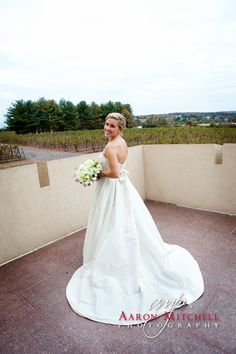 A beautiful bride on the balcony overlooking the vineayrd