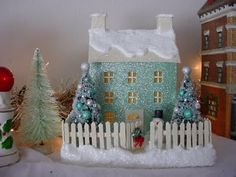 Hazelruthes's: Little Putz Houses--This one was made by Zoe H and it is just beautiful with it's aqua glitter. It really shines and the trees are so pretty encrusted with snow and ornies and a cute little snowman to greet you at the front door. I want to live in this little house!
