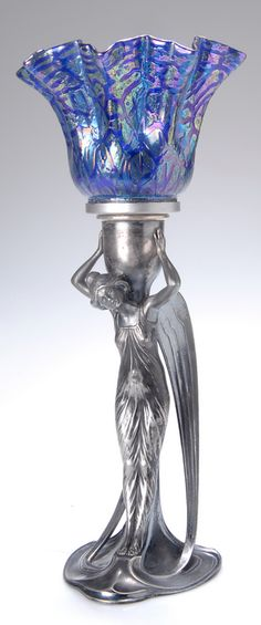 WMF figural angel lamp, c. Britannia metal, the angel supporting a Loetz type floriform glass shade, 31 cm H. Art Nouveau, Art Deco, Wmf, Antique Lamps, Pottery Designs, Glass Shades, Pewter, Silver Plate, Candle Holders