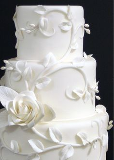 White cake with sugar flowers and vines