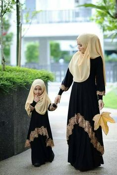 Gorgeous black abaya with golden lace. The little girl is looking really cute in this abaya.