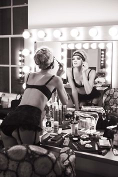 I love the heat from an unnecessary amount of hot bulbs around a theater dressing room mirror. ~E.M.C