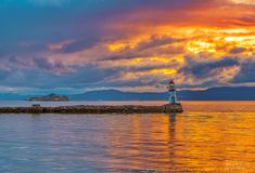 Ladelighthouse and Munkholmen before the storm! - www.aziznasutiphotography.com                        Shot in Trondheim Ladestien, Norway