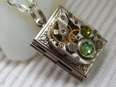 Items similar to Steampunk book locket necklace vintage watch movement and Swarovski crystals, Gift for Her for readers photo locket, picture locket on Etsy Steampunk Book, Mode Steampunk, Steampunk Necklace, Steampunk Fashion, Steampunk Keyboard, Steampunk Guitar, Steampunk Watch, Steampunk Design, Watch Necklace