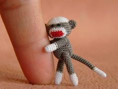 This amigurumi sock monkey is so tiny. It takes alot of patience and a steady hand to make something so small. Amigurumi is a f. Crochet Sock Monkeys, Crochet Animals, Crochet Toys, Knit Crochet, Cute Things From Japan, Little Doll, Crochet Projects, Art Projects, Lana