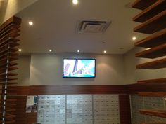 TV wall mount installation in mail room in a condo Hide Cables, Hide Wires, Tv Wall Mount Bracket, Wall Mounted Tv, Tv Wall Mount Installation, Mail Room, Separating Rooms, Concrete Slab, Plaster Walls