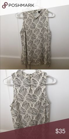 ASTR Mock Neck Swing Tank S A sleeveless A-line top with a keyhole detail and hi-lo hem. Never worn without tags. Small. ASTR Tops Tank Tops