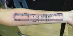 Musical piece on a staff - jpegtattoos@gmail.com - Metamorph Tattoo, Chicago, IL