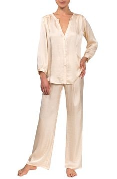 An elegant way to head to bed, this silky pajama set is comprised of a pretty split-neck top and flowing wide-leg pant for a sweet way to sleep. Style Name:Everyday Ritual Jamie Pajamas. Style Number: 6182604. Available in stores. Ways To Sleep, Clothing Items, Wide Leg Pants, Pajama Set, Jumpsuit, Nordstrom, Silk, Clothes For Women, Elegant