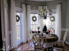 hanging sheer curtins really high in breakfast nook area- still allow the sun light to come in.