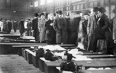 Next of kin attempt to identify victims of the Triangle Shirtwaist Company fire, New York City, 1911.