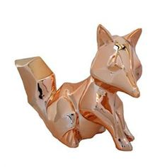 Warm copper ceramic moneybox in the shape of a geometric fox. Measures 17cm long by 13cm high.