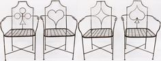 """20th century. Set of four matched vintage mid century modern style cast iron """"bridge"""" or card motif. Backs of patio chairs with representation of playing card suite on back including heart, diamond, club and spade. Woven iron metal seat over cross stretcher."""