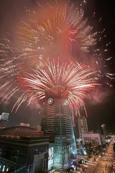 A fireworks display is set off from the Taipei 101 skyscraper during the New Year's Eve celebrations in Taipei, Taiwan, Friday, Jan. 1, 2016. (AP Photo/Wally Santana)