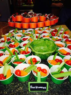 Herbivores food at dinosaur party.  Veggies and fruit in easy to grab cups.