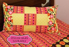 http://sew4home.com/projects/pillows-cushions/349-stylish-baby-nursery-patchwork-pillow