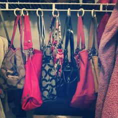 Organize purses with shower curtain rod hooks. Genuis. Follow this girl and all of her smart tips  lovely decor and repurposed furniture.